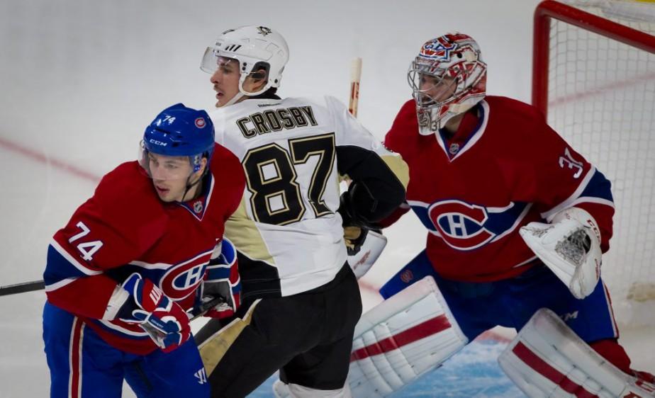 La vedette des Penguins pris en sandwich entre Carey Price et Alexei Emelin. (André Pichette, La Presse)