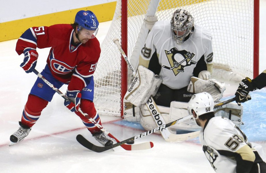 Nov 18, 2014; Montreal, Quebec, CAN; Pittsburgh Penguins goalie Marc-Andre Fleury (29) makes a save against Montreal Canadiens center David Desharnais (51) during the third period at Bell Centre. Mandatory Credit: Jean-Yves Ahern-USA TODAY Sports (Jean-Yves Ahern)